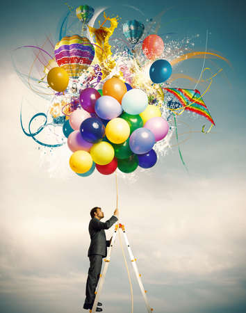 Photo for Creative businessman with colorful balloon explosion - Royalty Free Image