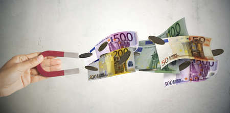 Magnet attracts many banknotes and money