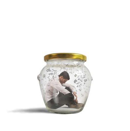 Concept of hermetic businessman closed in a jar