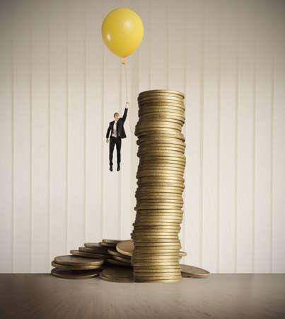Man flying with balloon. concept of earning money