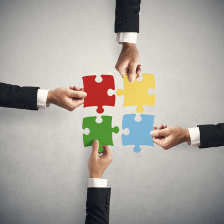 Foto de Teamwork and partnership concept with puzzle - Imagen libre de derechos