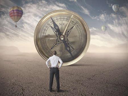 Photo pour Businessman looking for the destination of business compass - image libre de droit