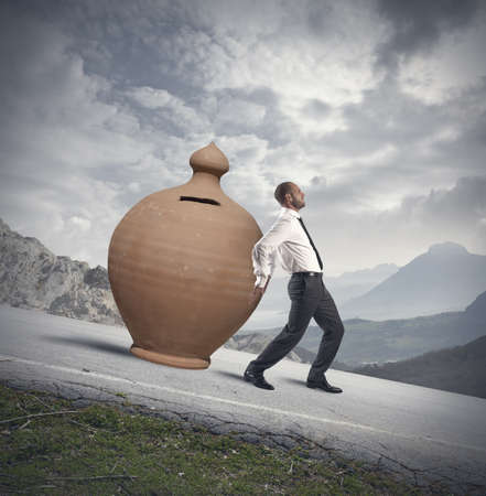 Concept of Savings protection with moneybox and businessman