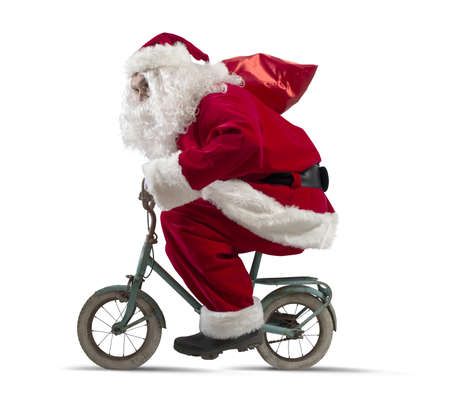 Santa claus on the bike on white background