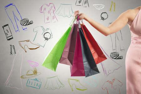 Foto de Shopping concept with several colorful shopping bags and drawing - Imagen libre de derechos