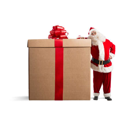 Magic Christmas with Santa Claus with a big gift