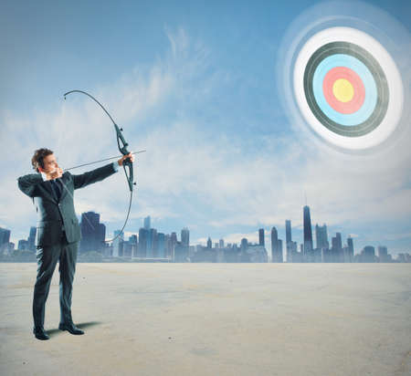 Concept of determinated businessman with bow and arrow