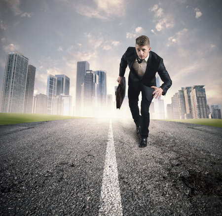 Business in action with running businessman in a road