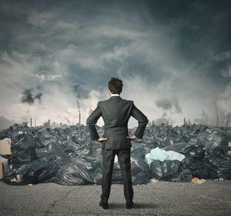 Businessman against a field full of trash
