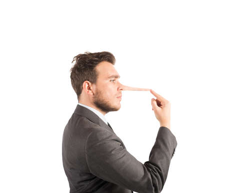 Concept of lie with businessman with long nose