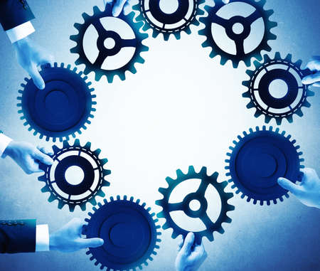 Photo pour Teamwork and integration concept with businesspeople that holds gears - image libre de droit