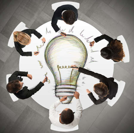 Photo pour Teamwork draws a big idea during a meeting - image libre de droit
