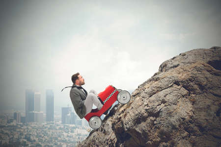 Foto de Businessman driving a fast car in a mountain - Imagen libre de derechos