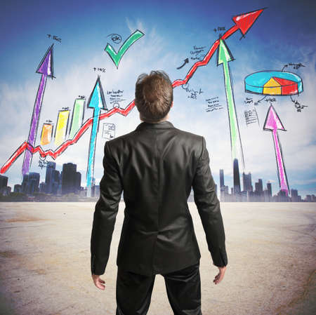Photo for Businessman watchs successful statistics of a company - Royalty Free Image