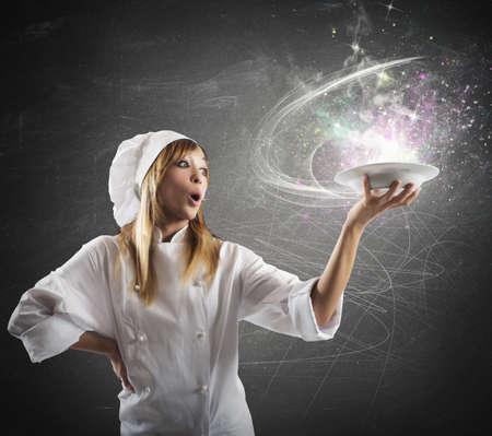 Beautiful chef prepares a magic glowing recipe