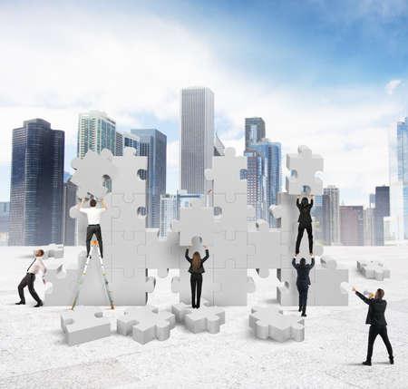 Foto de Business people builds  together a new company - Imagen libre de derechos