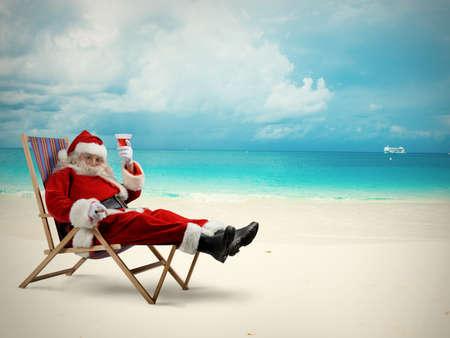 Santaclaus relaxes in a deckchair on beach
