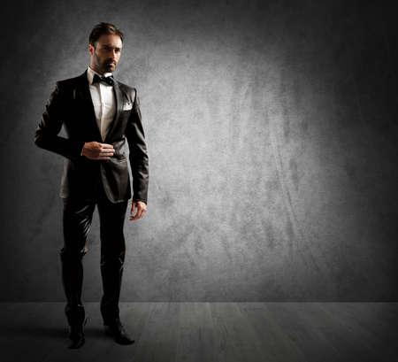 A businessman wearing an elegant black tuxedo