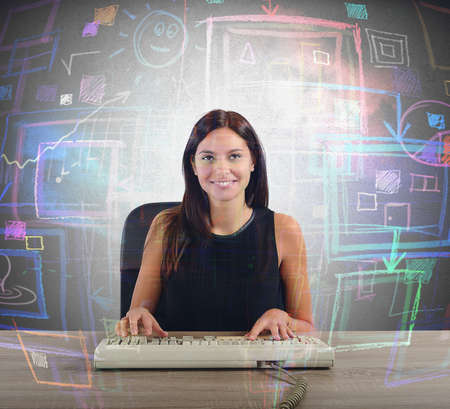 A businesswoman works on her big screen