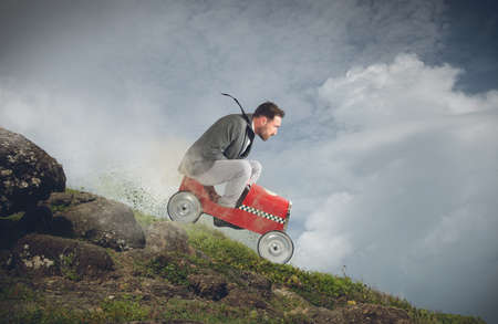 Photo for Businessman playing with car and goes down - Royalty Free Image