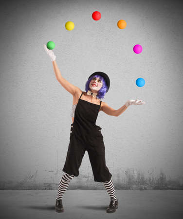 Clown playing with balls like a juggler