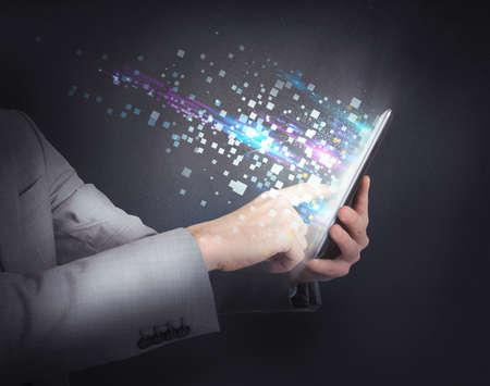 Foto de Businessman surfing the internet with the tablet - Imagen libre de derechos
