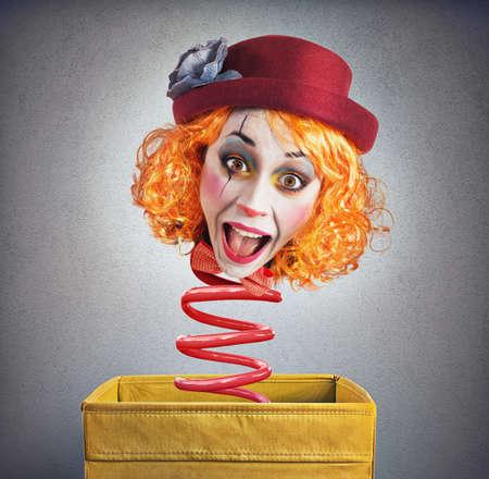 Photo pour Strange funny magic box clown with spring - image libre de droit