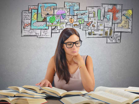 Photo pour Girl studying all academic subjects for examination - image libre de droit
