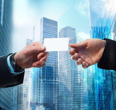 Photo pour Passage of business card between business person - image libre de droit