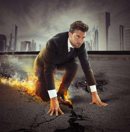 Determined businessman leaving fire trails on asphalt