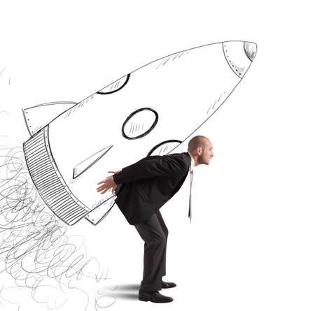 Foto de Businessman dreams to achieve success with spaceship - Imagen libre de derechos