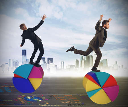 Photo pour Business people as finance and economy acrobats - image libre de droit