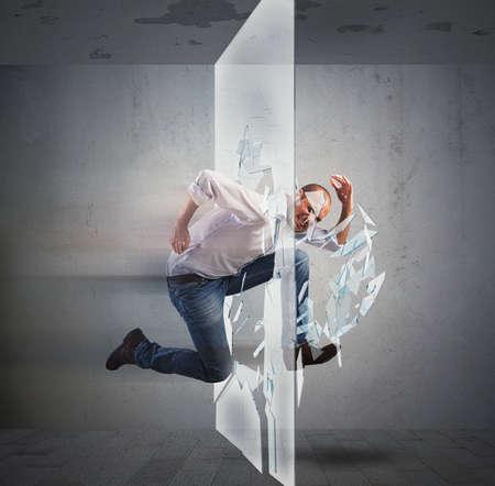 Photo pour Determined businessman runs and breaking a glass - image libre de droit