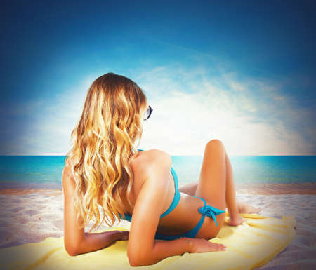 Girl in bikini sunbathing at the beach