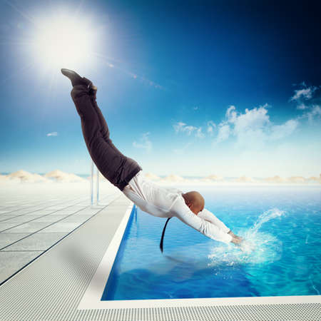 Businessman suit dives into the swimming pool