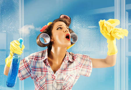 Photo for Pin-up housewife breathes on a clean glass - Royalty Free Image
