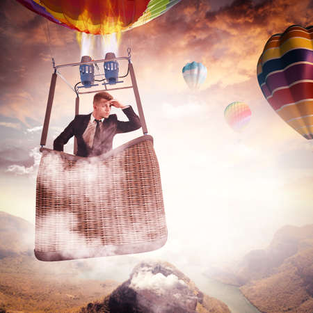 Businessman looking in a hot air balloon
