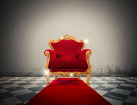 Photo for Sparkling golden armchair in a red carpet - Royalty Free Image