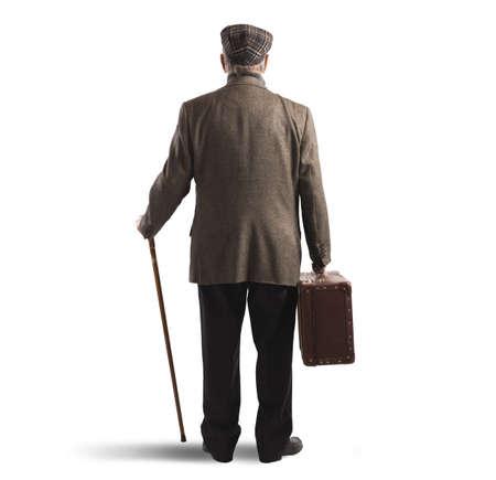 Photo pour Old man back with suitcase and stick - image libre de droit
