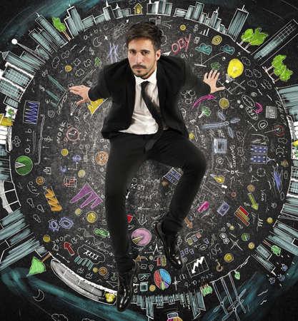 Businessman sitting on a circle of symbols