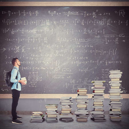 Student boy with backpack with scale books