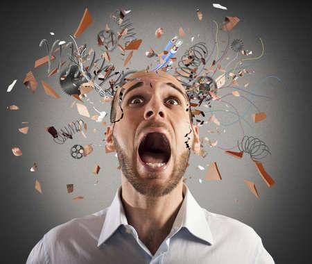 Photo pour Stressed businessman with broken mechanism head screams - image libre de droit