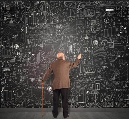 Genius business senior write on the blackboard