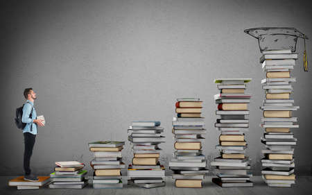 Student climbing a ladder of study books