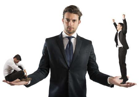 Photo pour Businessman holds man sad and one happy - image libre de droit