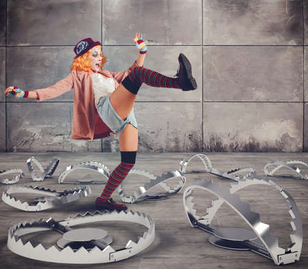 Clown walks with skills between big traps