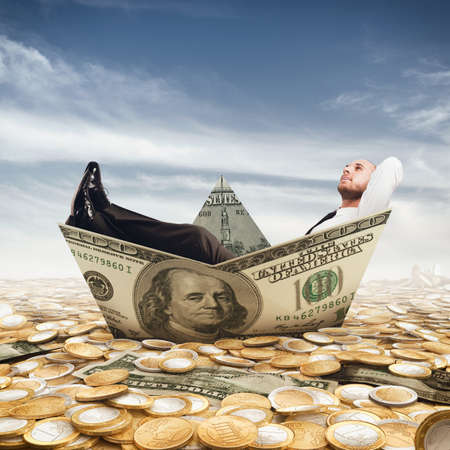 Businessman relaxed on a boat of banknote