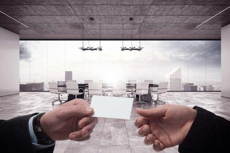 Photo pour Businessperson exchanging a business card in office - image libre de droit