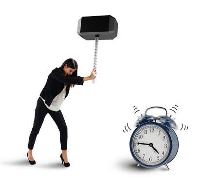 Woman breaks with a hammer an alarm