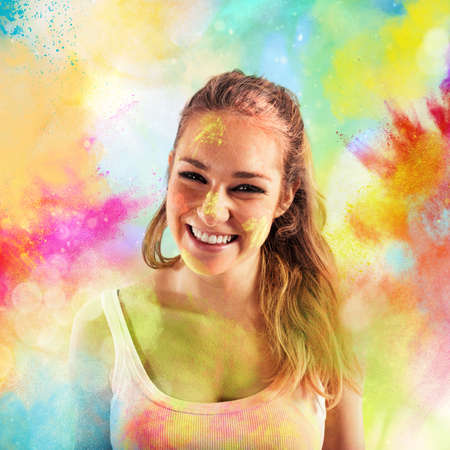 Foto de Laughing girl on background of colored powders - Imagen libre de derechos